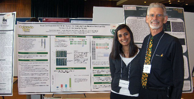 An Environmental Health undergraduate student presents her research poster at the CURC annual event