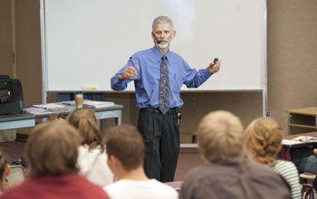 David Gilkey lecturing to Environmental Health students