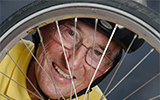 Dr. Cleon Kimberling with bike wheel