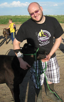 Chuck Yurkon with a calf